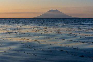 Atlasof Island with Alaid volcano at sunset (Photo: Tom Pfeiffer)