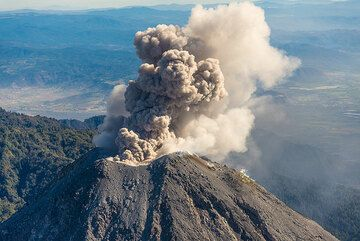 A second overflight over Colima volcano was undertaken on the morning of 28 Feb 2015. Luckily, by the time we arrived at the volcano, circling the crater at 14,000 ft (4200 m altitude i.e. approx. 250 m higher than the crater), a phase of frequent small to moderate eruptions began that could be observed from close range from the windows of a small Cessna airplane.  (Photo: Tom Pfeiffer)
