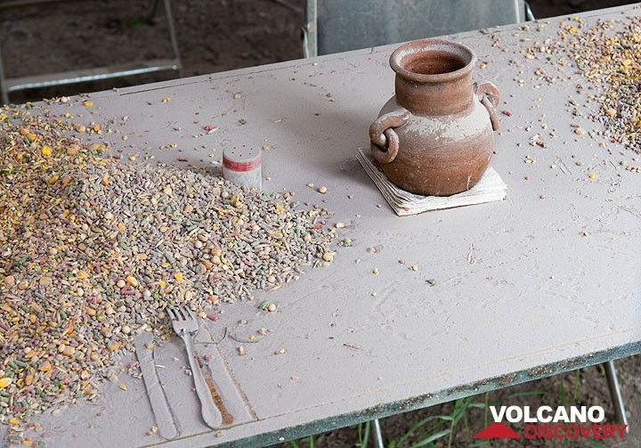 Corn - food for the chicken - has been left on the table of the tavern when people left. (Photo: Tom Pfeiffer)
