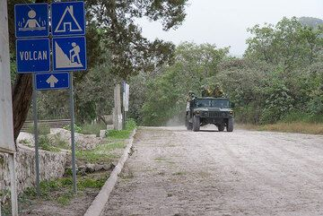 Military patrols the evacuated areas to prevent looting. (Photo: Tom Pfeiffer)