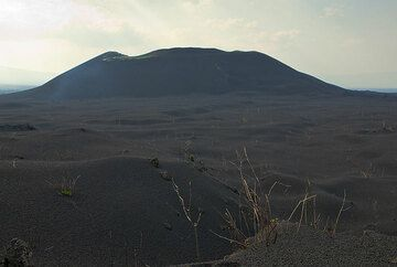 The western cone of Kimanura, with the ash plain in front. (Photo: Tom Pfeiffer)