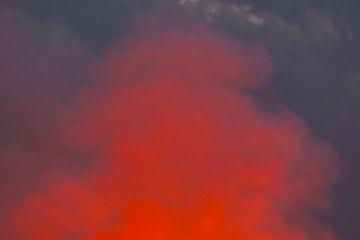 Orange steam against bluish clouds. (Photo: Tom Pfeiffer)