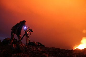 Documentary maker in action – note the long exposure flying lava blobs from the western crater. There was so much light, no need for flashlight. (Photo: Paul Hloben)
