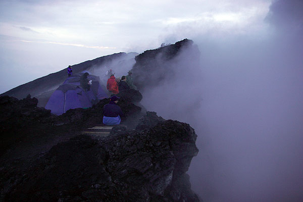 On the rim of Nyiragongo's crater, which currently is filled with steam and gas. (Photo: Tom Pfeiffer)