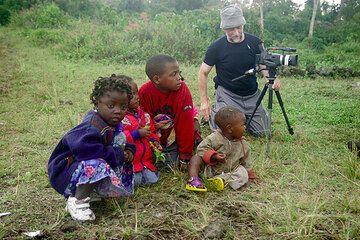 Children interested in Norbert's filming equipment. (Photo: Tom Pfeiffer)