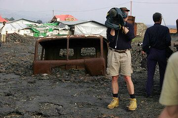 Filming episodes in the devastation area of Goma, where the lava flow from the 2002 flank eruption destroyed a large part of the town center. Entire vehicles were trapped and burned in the fast-flowing lava. (Photo: Tom Pfeiffer)
