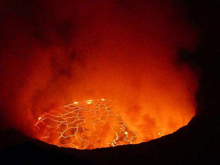 Nyiragongo´s lava lake in the early hours of 8 June 2017. Strong degassing from the rim of the lake creates plumes which reflect the lava´s red glow and partially obscure the view onto the lake´s surface. (Photo: Ingrid Smet)