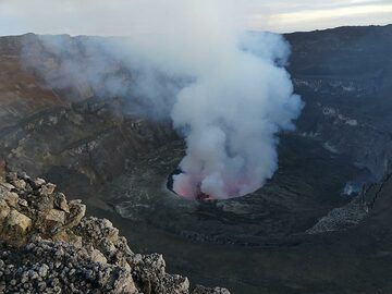 View onto the central part of the Nyiragongo summit caldera with its different terraces and ca 220 m diameter active lava lake, some 400 m below the caldera rim. (Photo: Ingrid Smet)