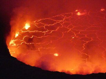 The ghostly red glow and bright yellow fracture pattern and gas bubble explosions of the lava lake in the evening of 8 June 2017.  (Photo: Ingrid Smet)