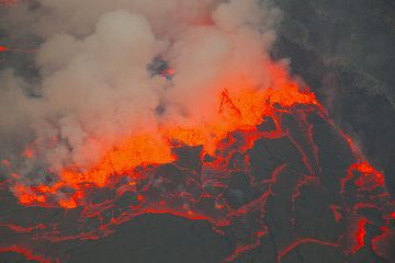 """A violently boiling """"fissure"""" of lava fountains has reached the shore of the lake, forming a ca. 20 m high wall around the lava lake. (Photo: Tom Pfeiffer)"""