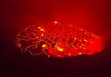 View of the lava lake at night, partly obscured by fumes. It's impossible to photograph the real sight - raising emotions, pictures and dreams of the birth of earth.  (Photo: Tom Pfeiffer)