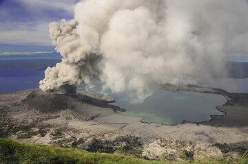 Ash-spewing Tavurvur volcano and the ash-covered Bay of Rabaul, Papua New Guinea  (Photo: Paul Nicholson)
