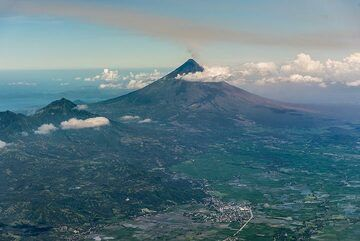 22 Feb 2018: as we fly towards Legazpi, Mayon volcano comes into view as we pass its northern neighbor, the older stratovolcano Masaragi visible in the left part of the photo. (Photo: Tom Pfeiffer)
