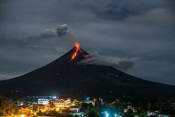 Mayon with a steam plume and the southern and southeastern lava flows seen from a hill in Legazpi, with parts of the city at the foot of the volcano. (Photo: Tom Pfeiffer)