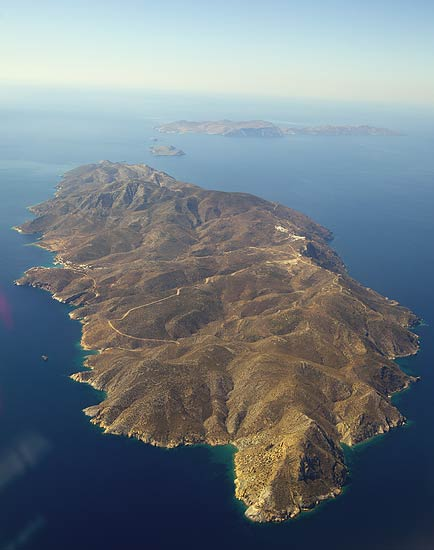 Aerial view of the Island of Sikinos seen from the NE. Folegandros Island in the background. (Photo: Tom Pfeiffer)