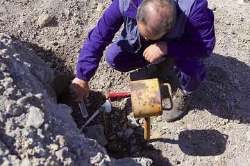 Scientist taking a gas sample from a fumarole at Nea Kameni (Photo: Tom Pfeiffer)