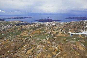 Aerial view of the eastern part of Santorini with the caldera behind. The capital Fira is in the center of the image. (Photo: Tom Pfeiffer)