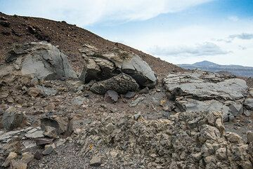 A giant bomb spit into 3 parts on impact about 300 m from the crater rim. (Photo: Tom Pfeiffer)