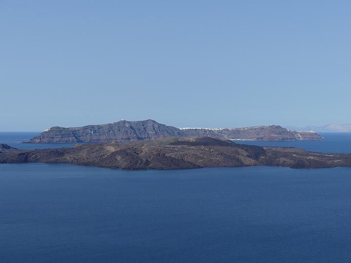 The youngest volcanic island of the Santorini group, Nea Kameni, is formed in the centre of the olde calder. The island of Therasia in the back ground is part of the older volcanic  caldera. (Photo: Ingrid Smet)