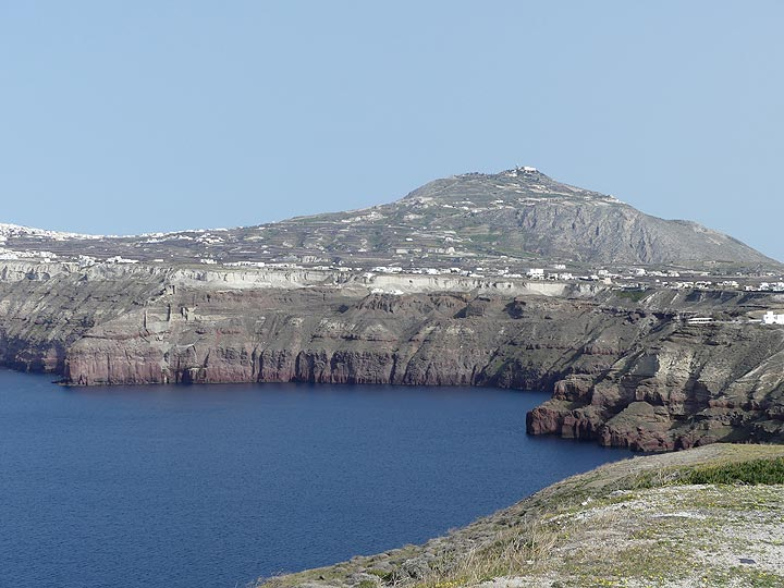 View of the the central caldera cliffs and the limestone mountain of Profitis Ilias which represents another part of the pre-volcanic island of Santorini. (Photo: Ingrid Smet)