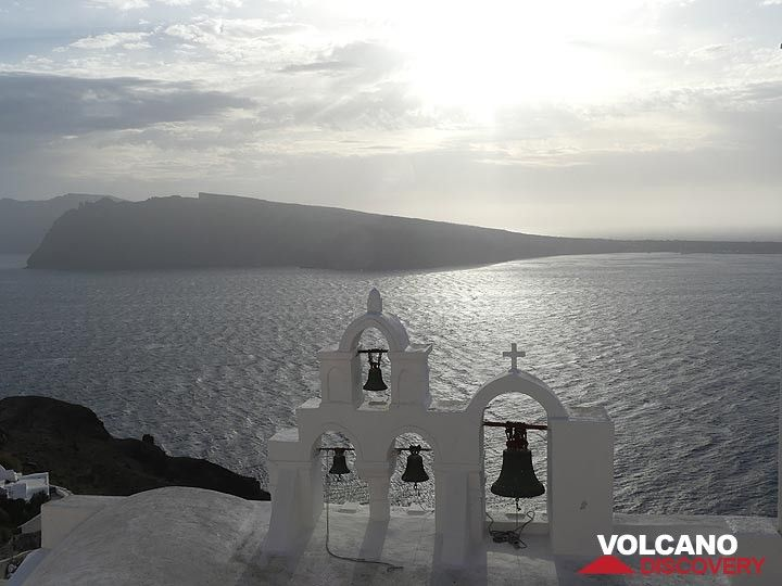 Oia bells tall on a winter afternoon - Therasia island in the background. (Photo: Ingrid Smet)