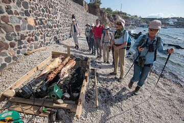 As it is (orthodox) Easter Sunday, roasted lamb (or goat) is a tradition seen everywhere. The preparation starts in the morning, as it takes several hours of slow grilling on the turning spit over charcoal... We'll see later! (Photo: Tom Pfeiffer)