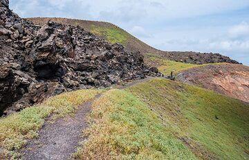 Part of the viscous 1941 Niki lava flow (black block lava) covering the 1928 surface on the left. (Photo: Tom Pfeiffer)