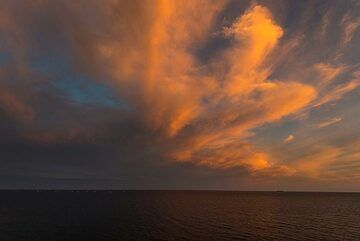 Clouds over the Aegean sea at sunset, seen from the south coast of Santorini (Photo: Tom Pfeiffer)