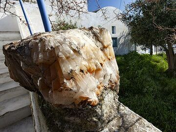 Calcite crystals from a quarry near Perisa. It is now on the wall next to the supermarket at the Pyrgos central square. (Photo: Tobias Schorr)