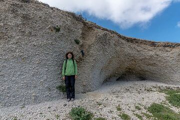 Marina posing as scale near a preserved ballistic impact from during the Minoan eruption. Such blocks have been flying for about 40 seconds, traveled 8 km horizontal and 15-20 km vertical distance before impacting at speeds of approx 200 m / second or 400 knots... (Photo: Tom Pfeiffer)