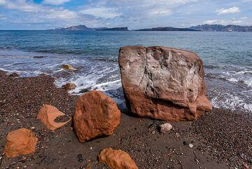 Broken blocks of red volcanic tuffs which had fallen from the caldera cliff. (Photo: Tom Pfeiffer)