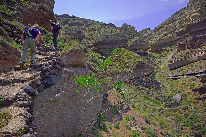 Climbing the impressive caldera cliffs with its many tuff layers exposed along a little trail (Photo: Tom Pfeiffer)
