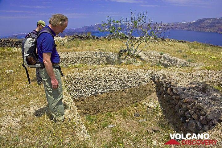 Small excavations revealing Minoan stone walls beneath the pumice layer of Santorini. (Photo: Tom Pfeiffer)
