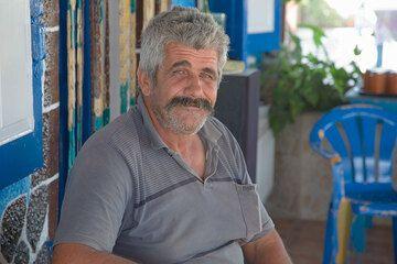 Captain Dimitris in his fish tavern (Photo: Tom Pfeiffer)