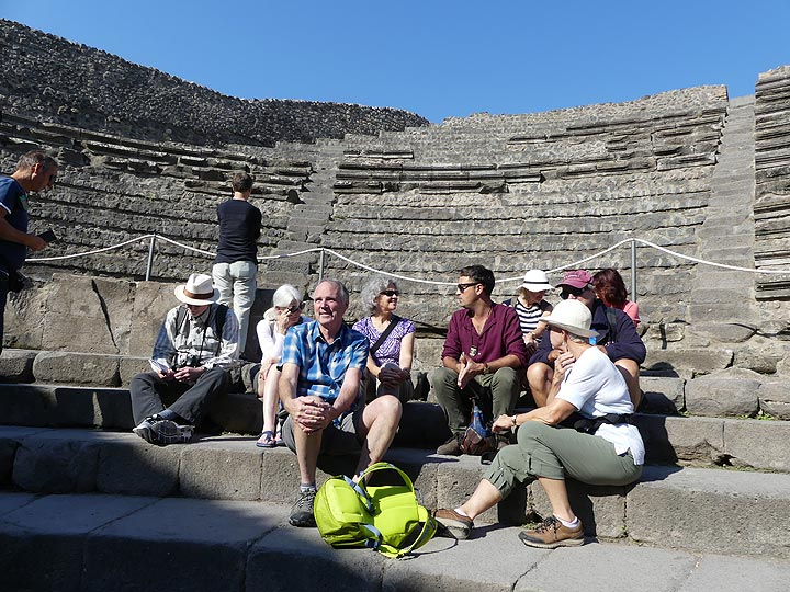 Taking in all the information shared by our Naples based historic guide Florian at the smaller theater of Pompeii. (Photo: Ingrid Smet)