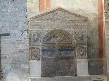 Despite the destructive power of the eruption, some valuable artifacts were preserved in the larger villas of Pompeii such as this intricate mosaic altar. (Photo: Ingrid Smet)