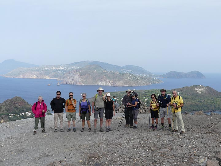 Group picture near the summit of the active crater on Vulcano, with the island of Lipari in the background. (Photo: Ingrid Smet)