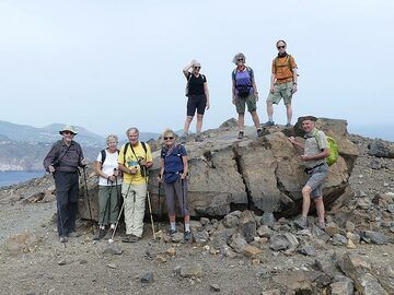 Group picture around a massive lava bomb that landed on the crater rim of La Fossa during one of Vulcano's historic eruptions. (Photo: Ingrid Smet)
