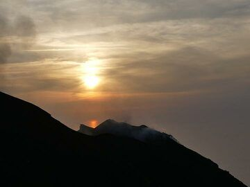 Sun almost setting behind the active northeast crater on Stromboli's summit. (Photo: Ingrid Smet)