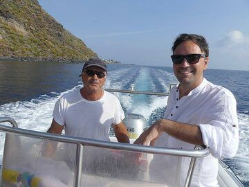 The captain of our private boat, Frank International, and our historic tour guide from Naples enjoying the morning boat trip. (Photo: Ingrid Smet)