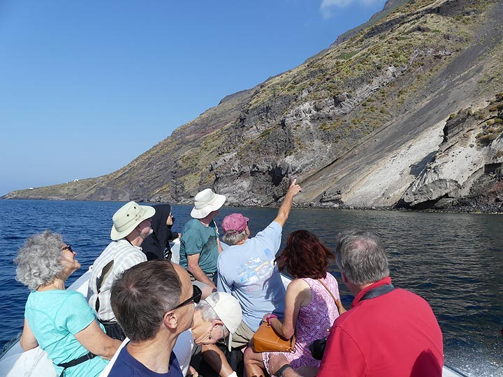 Observing and discussing the different volcanic deposits and textures visible along the island's coast as we sail around it. (Photo: Ingrid Smet)