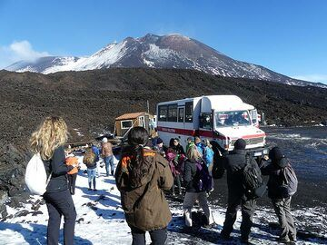 From there we take a special motorized bus-like vehicle that takes us up to about 3000 masl, the plateau on top of which the 4 summit craters of Mt Etna rise another 300 m higher. (Photo: Ingrid Smet)