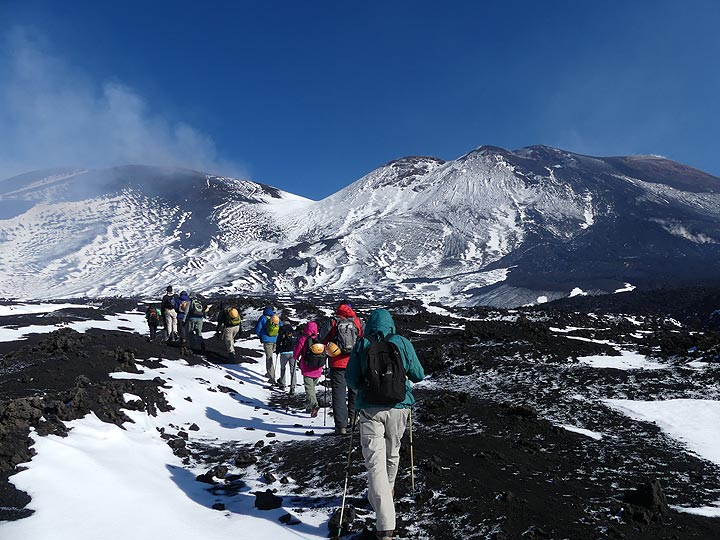 With our private mountain guide we start our hike up to the summit of the Bocca Nuovo - Voragine crater complex. (Photo: Ingrid Smet)