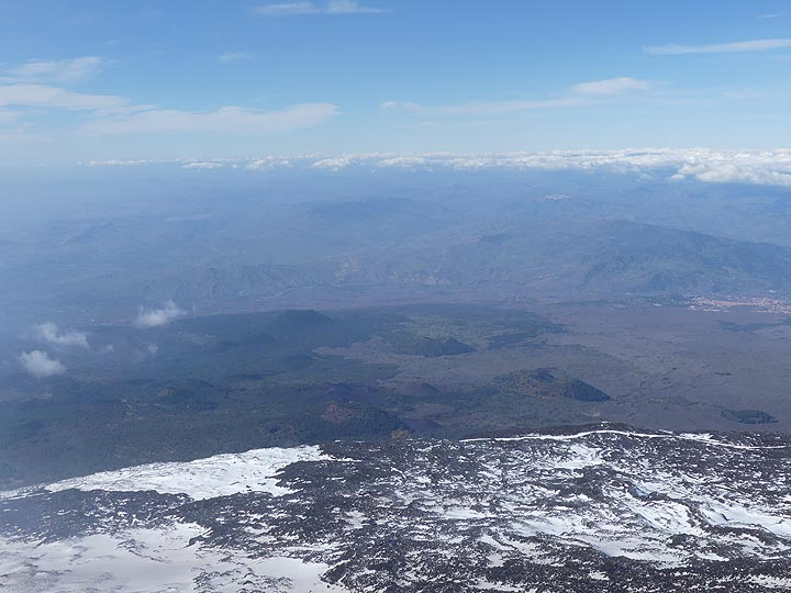 ... and looking out over the lower western flanks of Mt Etna which are dotted with monogenetic cinder cones (center). (Photo: Ingrid Smet)