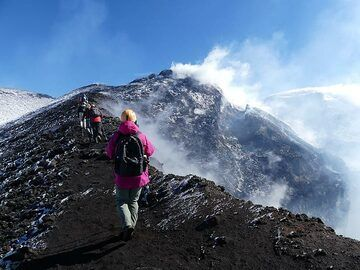 We walk clockwise along the rim of the Bocca Nuova crater from where the strongly degassing active vent has intermittent explosions. (Photo: Ingrid Smet)