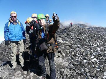 Etna specialist and tour organiser Emanuela Carone explains the eruptive history, deposits and recent changes of the volcano throughout our summit hike. (Photo: Ingrid Smet)