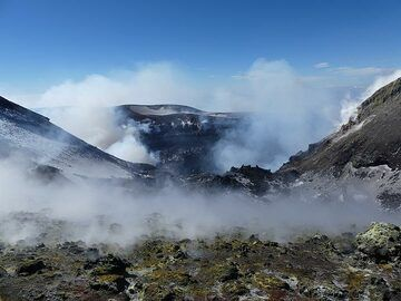 View from the saddle between the NE and Voragine craters to towards the latter, with the Bocca Nuova crater in the background. (Photo: Ingrid Smet)