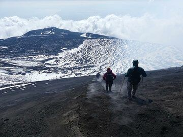Hiking down in the soft ash slopes of a volcanic cone is great fun! (Photo: Ingrid Smet)
