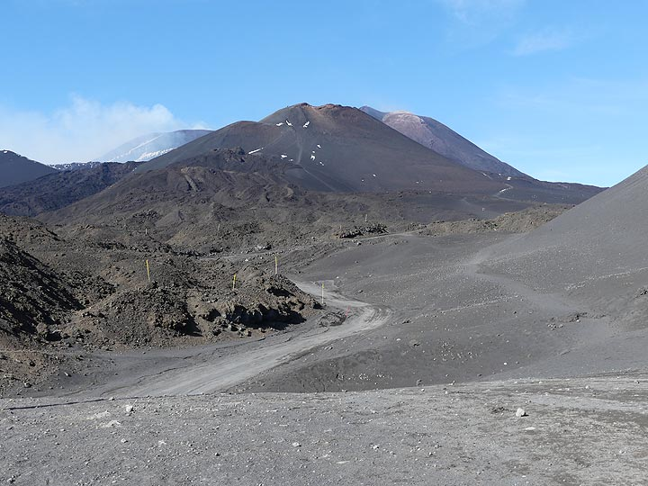 View towards the 2002 - 2003 cinder cones and Etna's summit area with the SE crater (right) and Bocca Nuova (left) behind them. (Photo: Ingrid Smet)