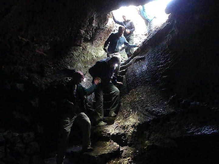 Descending down into one of Etna's many lava caves, the Grotta della Neve, which in historic times was used as spring and summer storage area for winter snow and ice. (Photo: Ingrid Smet)
